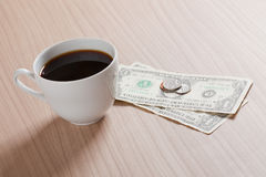 Coffee cup with money Stock Image