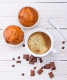 Coffee cup with a muffin . Royalty Free Stock Image