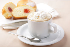 Coffee cup and muffins Stock Image