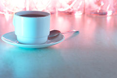 Coffee cup with multicolored light Stock Images