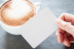 Coffee cup with name card on grey background Royalty Free Stock Photo