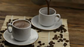 Coffee cup with natural grains. Coffee in coffee cup with natural grains stock video footage