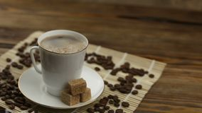 Coffee in  cup with natural grains. Coffee in coffee cup with natural grains stock footage