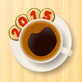 Coffee cup and New Year's cookies. Coffee cup and saucer and cookies with red numbers, forming together the number 2015, on the wooden background Royalty Free Stock Photos