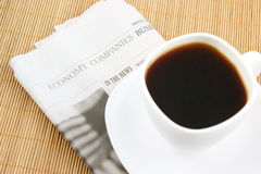 Coffee cup and newspaper Royalty Free Stock Images