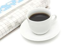 Coffee cup with newspaper Stock Images