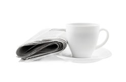 Coffee cup with newspaper isolated Stock Photography