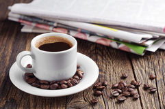 Coffee cup and newspaper Stock Image