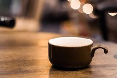 Coffee mug at a warm cozy cafe of Hanoi Stock Images