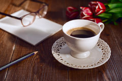 Coffee cup with note book and glases. Retro style pictures Royalty Free Stock Photos