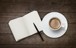 Coffee cup and note book Royalty Free Stock Photo