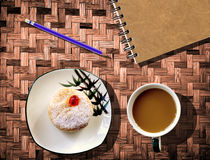 Coffee cup notebook  on bamboo Stock Photos