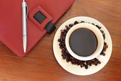 Coffee cup with notebook Stock Photo