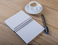 Coffee cup and notebook Stock Photos