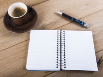 Coffee cup and notebook Stock Image