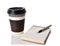 Coffee cup, notebook and ink pen Royalty Free Stock Image