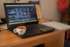 Coffee cup on a notebook. A coffee cup on a notebook pc Stock Photos