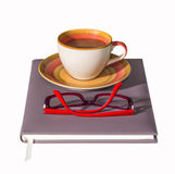 Coffee cup on notebook Royalty Free Stock Photo