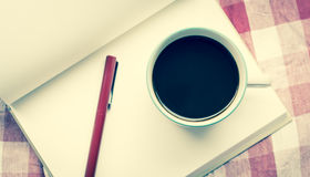 Coffee cup and notebook Stock Photography