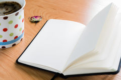 Coffee Cup And Notebook On Wooden Table With Copy Space Royalty Free Stock Photography