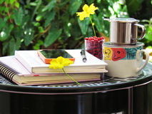 Coffee cup, notebooks, pencil and flowers on green steel table do it yourself. corner relax concept. Stock Image