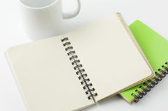 Coffee cup and notepad. Still life photography Stock Photo