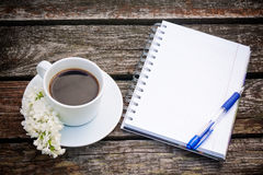 Coffee cup, notepad  and pen on wooden background Stock Photos