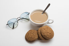 Coffee cup with oatcake Stock Images