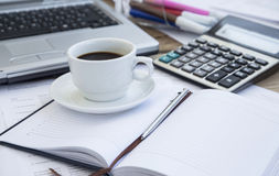 Coffee Cup at Office with Financial Papers,Agenda and Calculator Royalty Free Stock Images