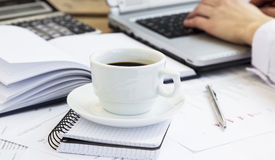 Coffee Cup at Office with Financial Papers and Businessman Worki Stock Image