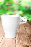 Coffee Cup and office supplies on old wood table Royalty Free Stock Photography