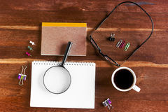 Coffee cup and office supplies. View from above. Closeup Stock Photos