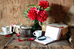 Coffee cup old book flower Stock Image