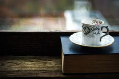 Coffee cup  with old book Stock Images