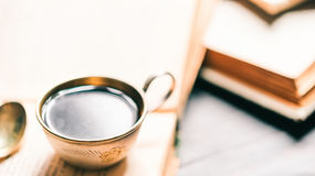 Coffee cup on old books Stock Photography
