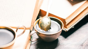 Coffee cup on old books Royalty Free Stock Images