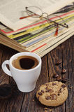 Coffee cup and old magazines Royalty Free Stock Photo