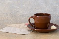 Coffee cup and old postcards Royalty Free Stock Image