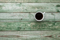 Coffee cup on old rustic table. Wood texture. Top view Stock Image