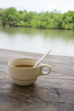 Coffee cup on old wood river background. Royalty Free Stock Photo