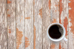 Coffee cup on old wooden table background Stock Image