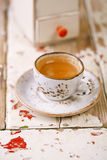 Coffee cup on old wooden table with retro coffe mill Royalty Free Stock Photography