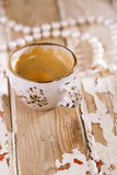 Coffee cup on old wooden table Royalty Free Stock Photos