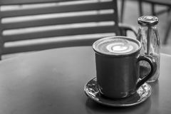 Free Coffee Cup On Black Metal Table In Coffee Shop With Wooden Floor Background. Stock Images - 103129094
