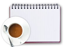 Coffee Cup On Notebook Stock Image