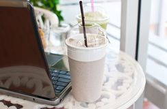 Coffee Cup On Wood With Laptop. Royalty Free Stock Photography