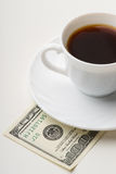 Coffee cup and one hundred U.S. dollars Royalty Free Stock Photography
