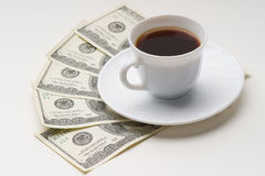 Coffee cup and one hundred U.S. dollars Stock Photos