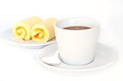 Coffee cup with orange cake roll. Royalty Free Stock Image