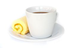 Coffee cup with orange cake roll. Royalty Free Stock Photos
